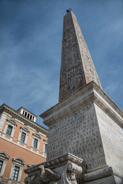 The Lateran Obelisk is the largest standing ancient Egyptian obelisk in the world, and it is also the tallest obelisk in Italy. It originally weighed 413 metric tons (455 tons), but after collapsing and being re-erected 4 meters (13 feet) shorter, now weighs around 300 metric tons (330 tons).[1][2] It is located in the square across from the Archbasilica of St. John Lateran and the San Giovanni Addolorata Hospital. Originally from the temple of Amun in Karnak,map the obelisk was first brought to Alexandria over the Nile by obelisk ship in the early 4th century along with the Obelisk of Theodosius by Constantius II. He intended to bring them both to Constantinople, his new capital for the Roman empire. The obelisk never made it there. (Wikipedia)