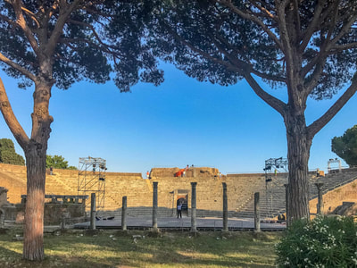 The Roman theater at Ostia Antica is staged for a dramatic performance by Ave Maria University students.